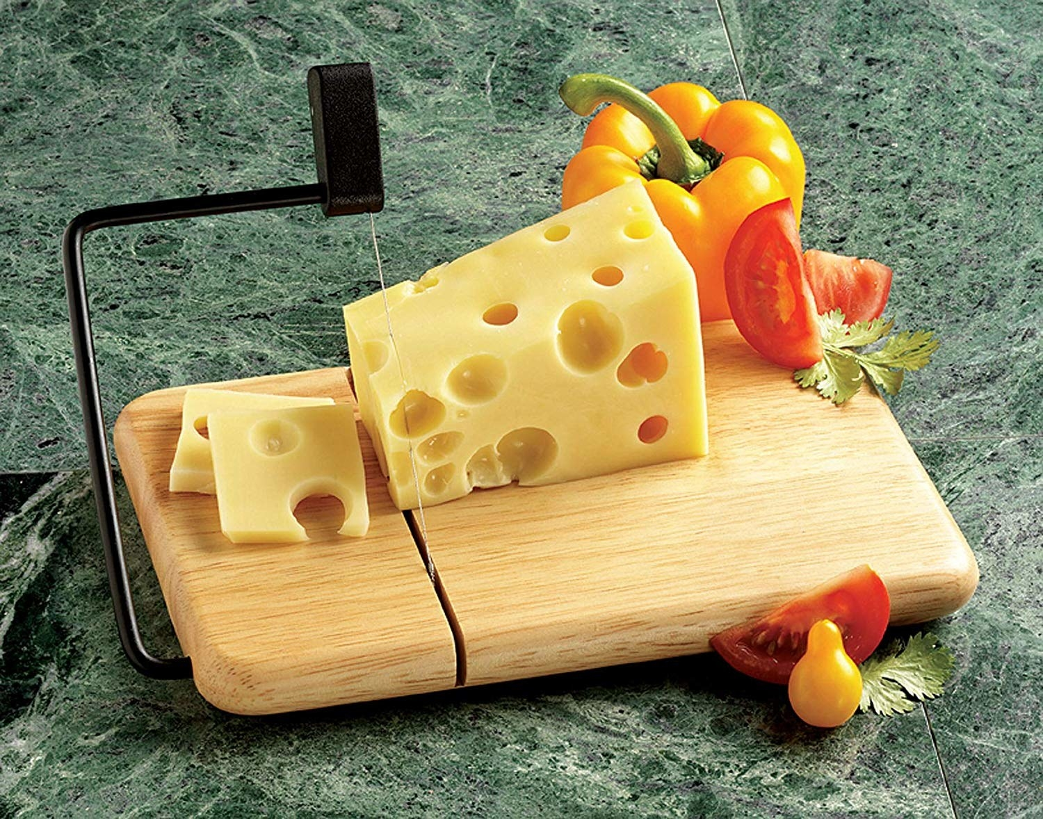 Cheese slicer with cheese on top