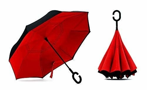 The umbrella with a black outside and red inside open and then closed next to it, showing how it closes in on itself