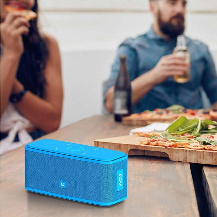 The rectangle-shaped speaker with control on the top in bright blue
