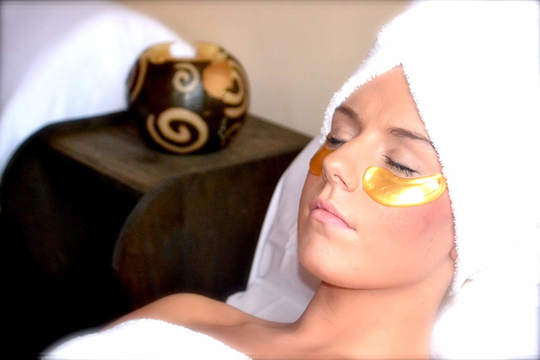 Model wearing the gold eye masks