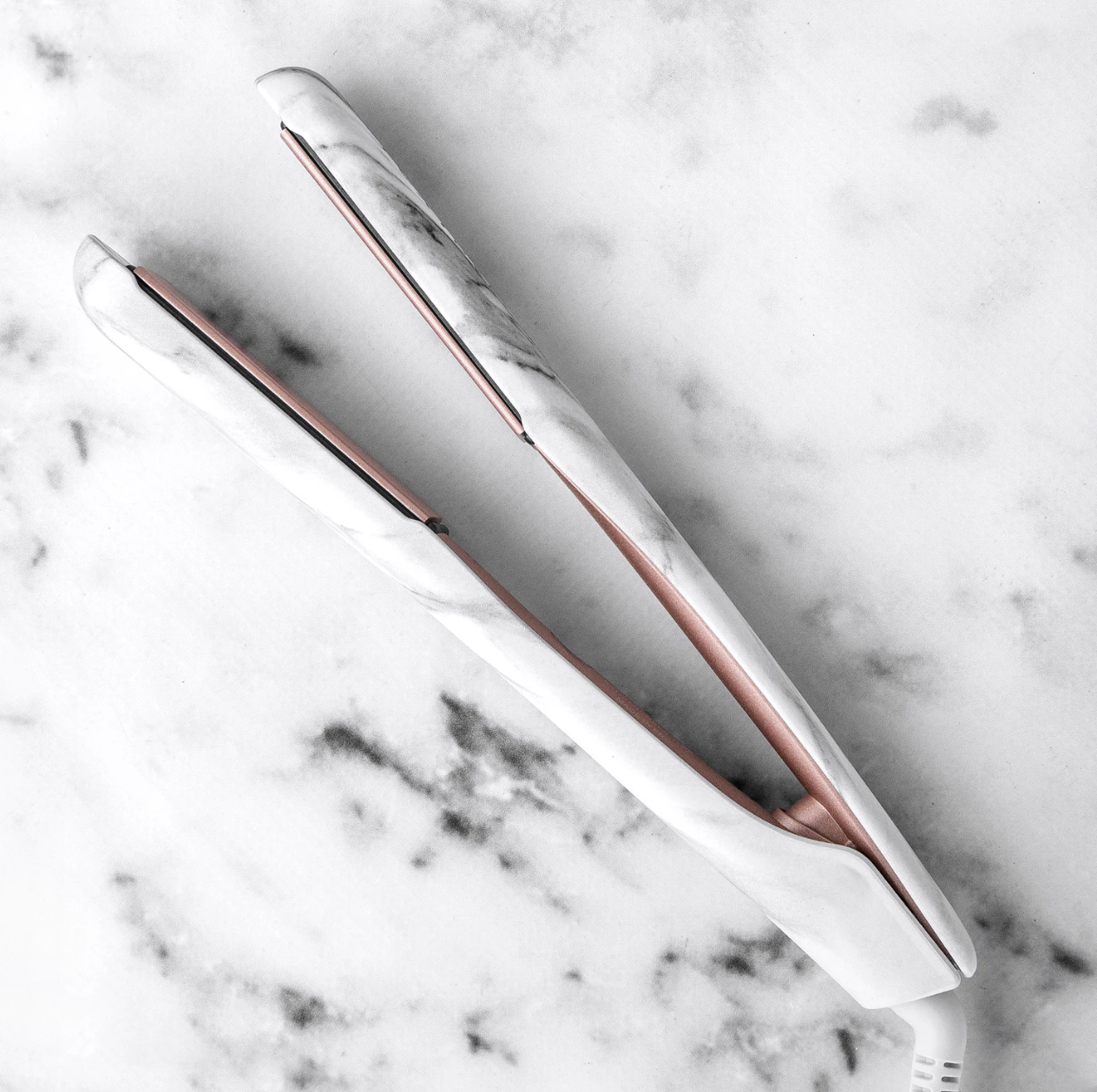 The white and gray marble straightener with rose gold plates