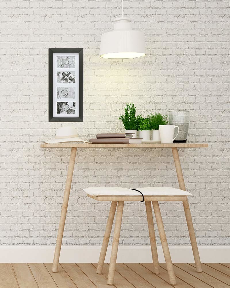 The picture frame hung on a white brick wall, above a bistro dining set