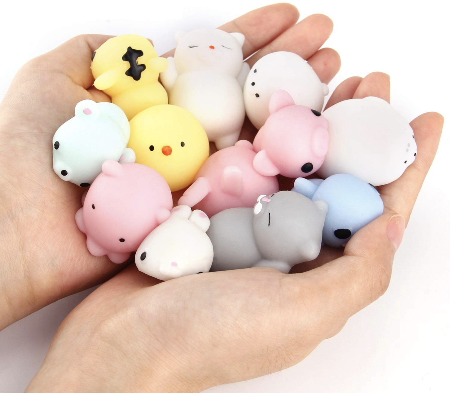 A model holding a handful of small squishies in the shapes of various animals