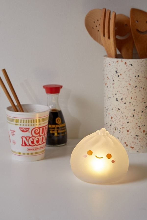 The small dumpling-shaped light with a smiley face on it
