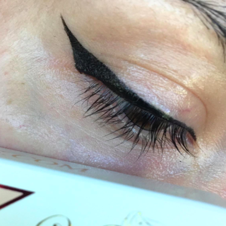 a reviewer showing how easy their cat eye came out with the tool
