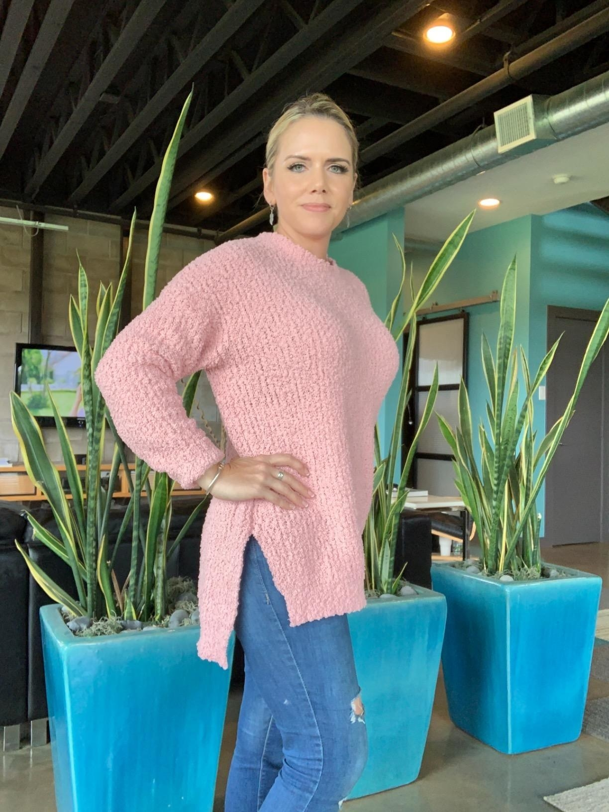 Reviewer in the pink chunky knit sweater
