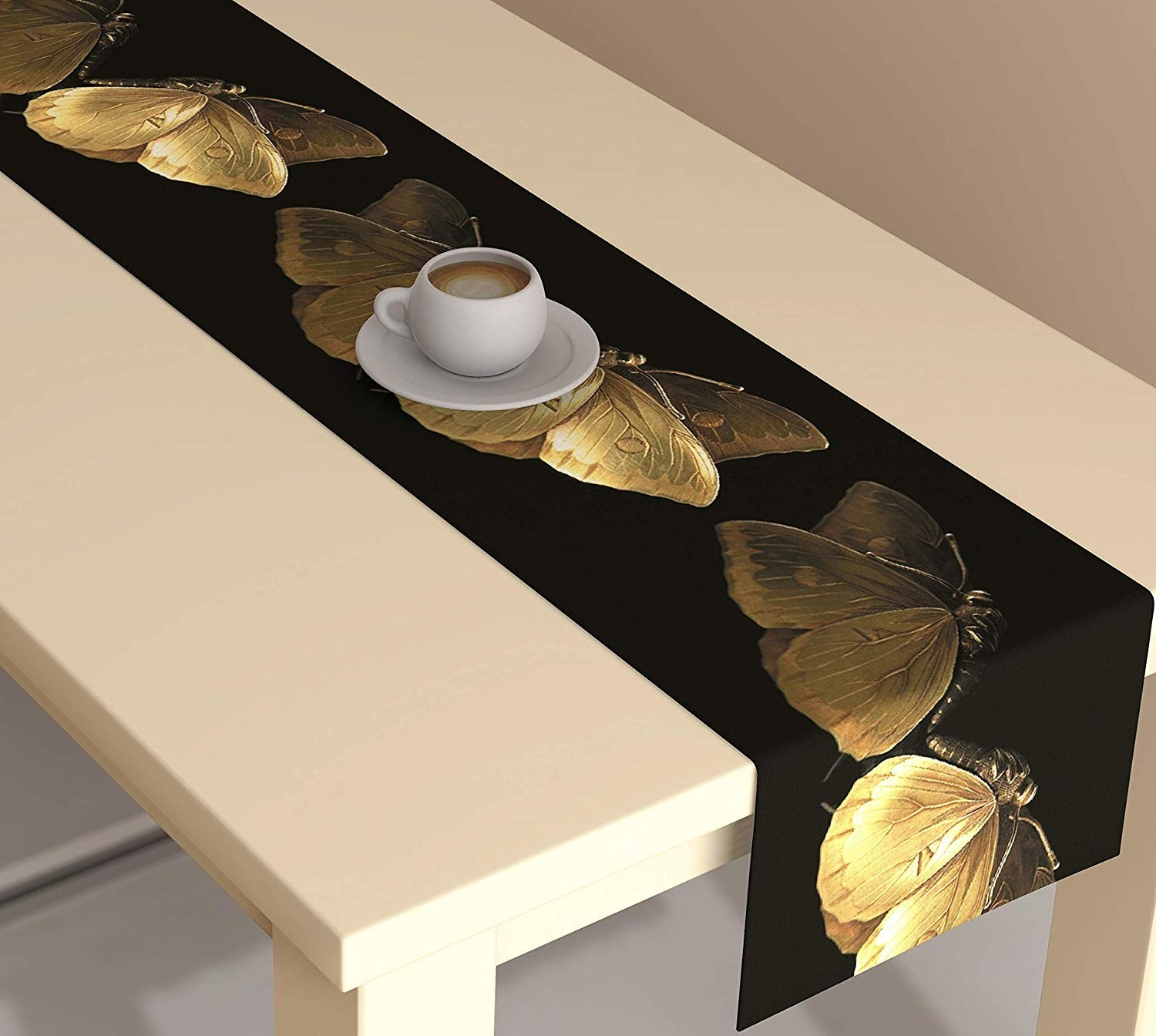 Table runner with golden butterflies on it placed on a table.