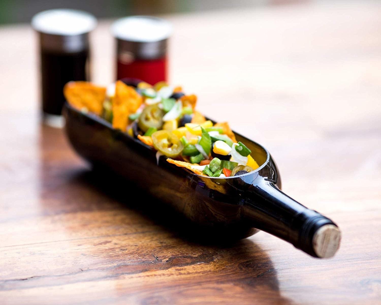 Nachos inside the bottle-shaped platter.
