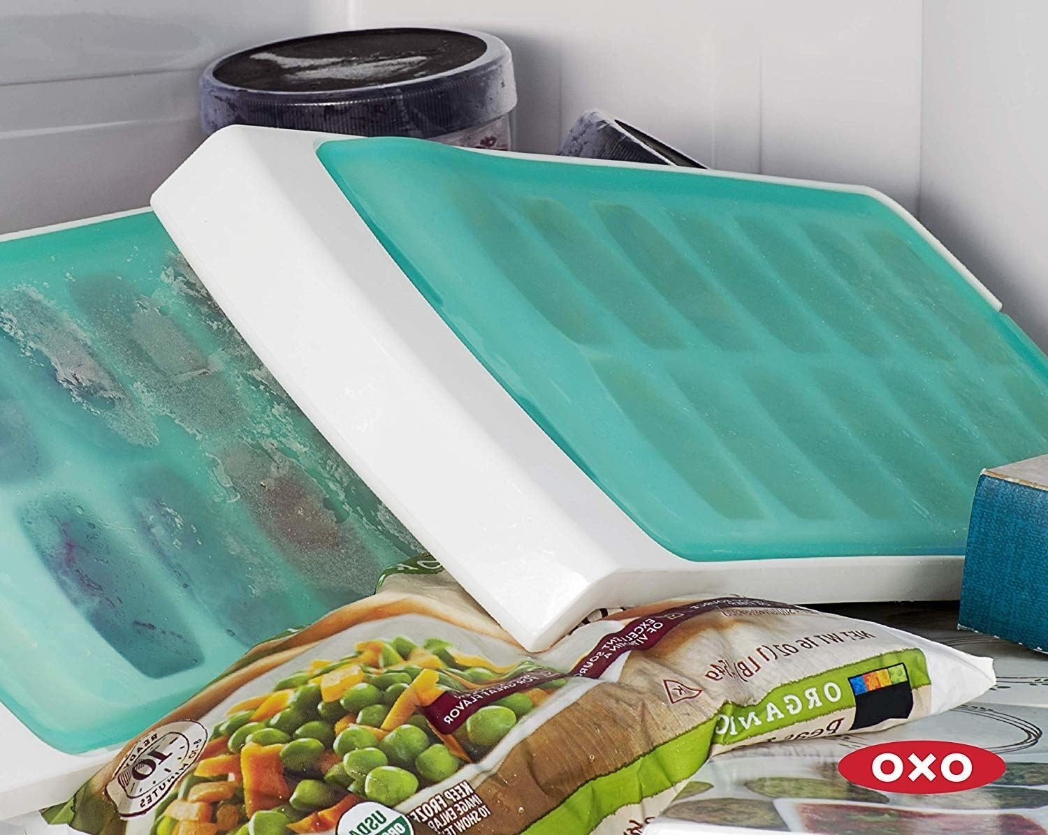 ice trays with silicone covers placed diagonally in freezer