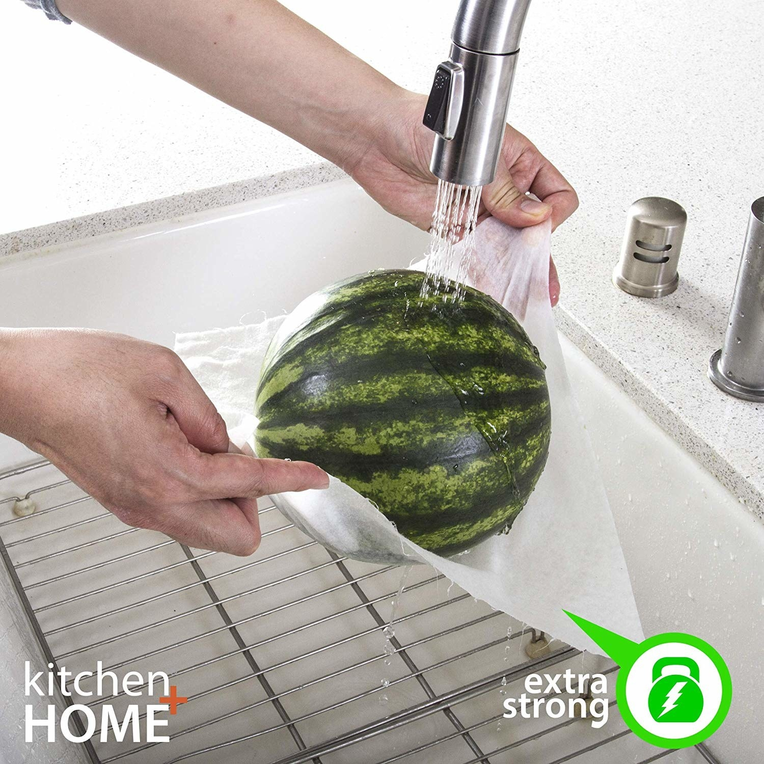 watermelon held in a paper towel under faucet