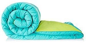 A teal and green reversible comforter.