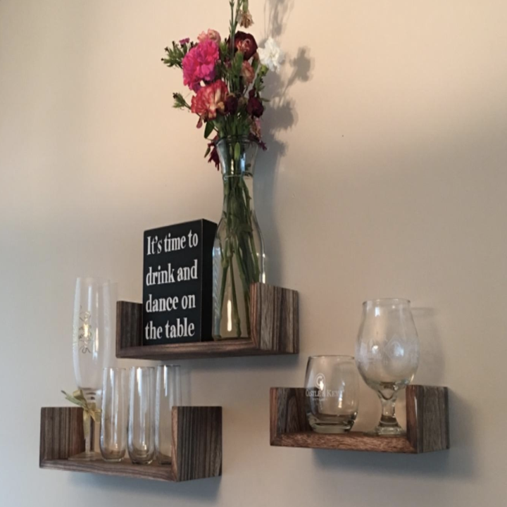 a reviewer's trio of shelves with glasses on them