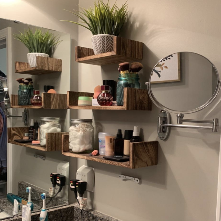 another reviewer's shelves in their bathroom with various products on them