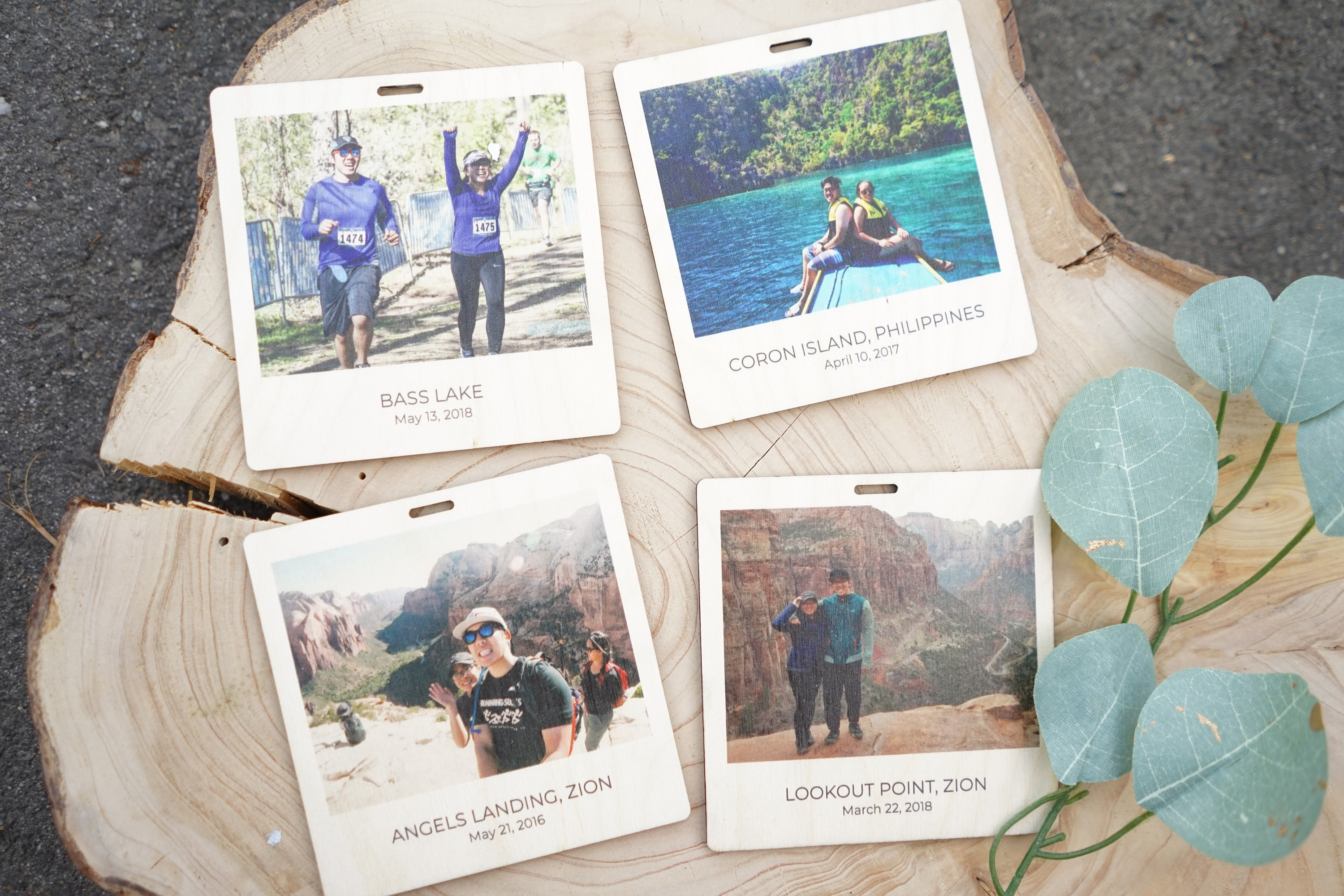 four personalized coasters featuring photos, location names, and dates