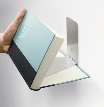 showing the book how it fits onto the book shelf bracket