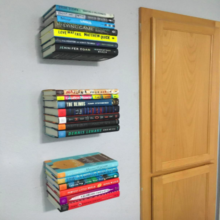 reviewer pic of three of the shelves installed with colorful books in place