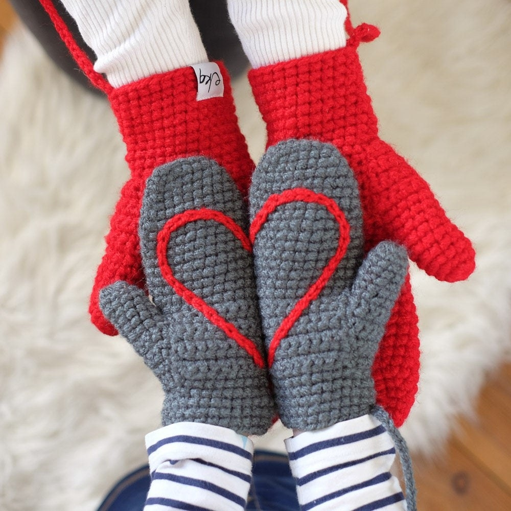 two halves of a heart sewn into each mitten