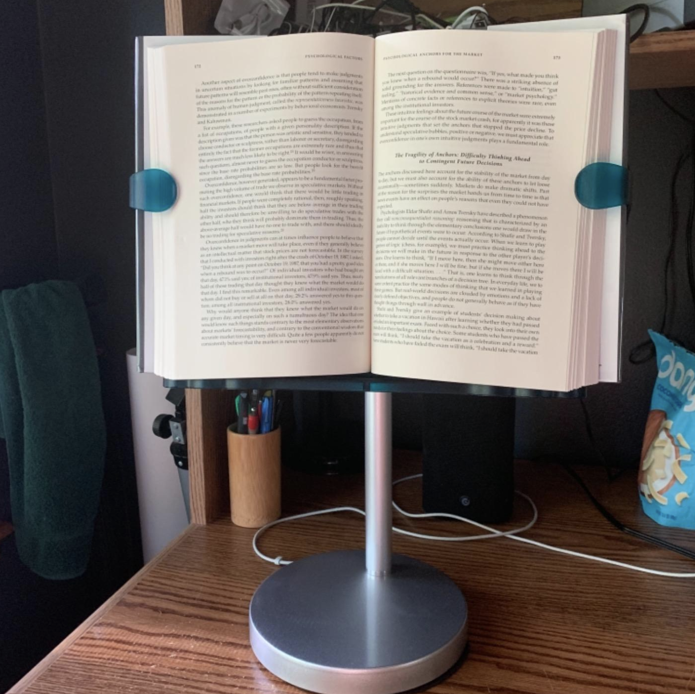 the book stand holding a big book up and open so the pages lay flat