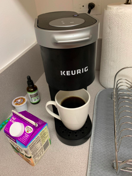 the Keurig in the corner of a small kitchen