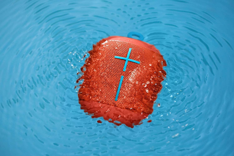 the speaker in orange floating in water