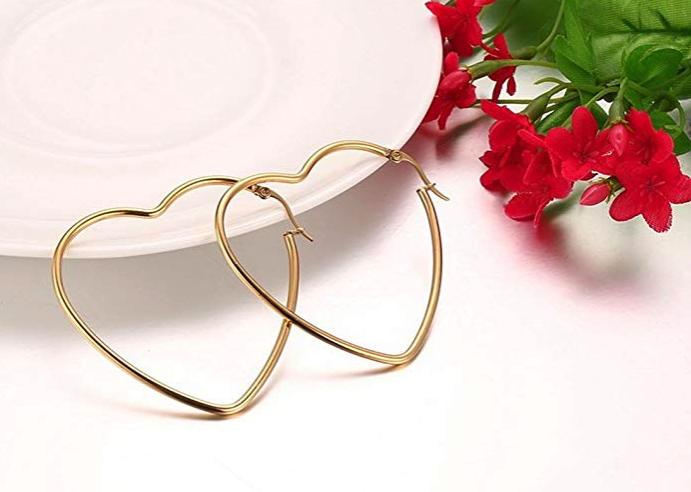 A pair of heart-shaped hoop earrings