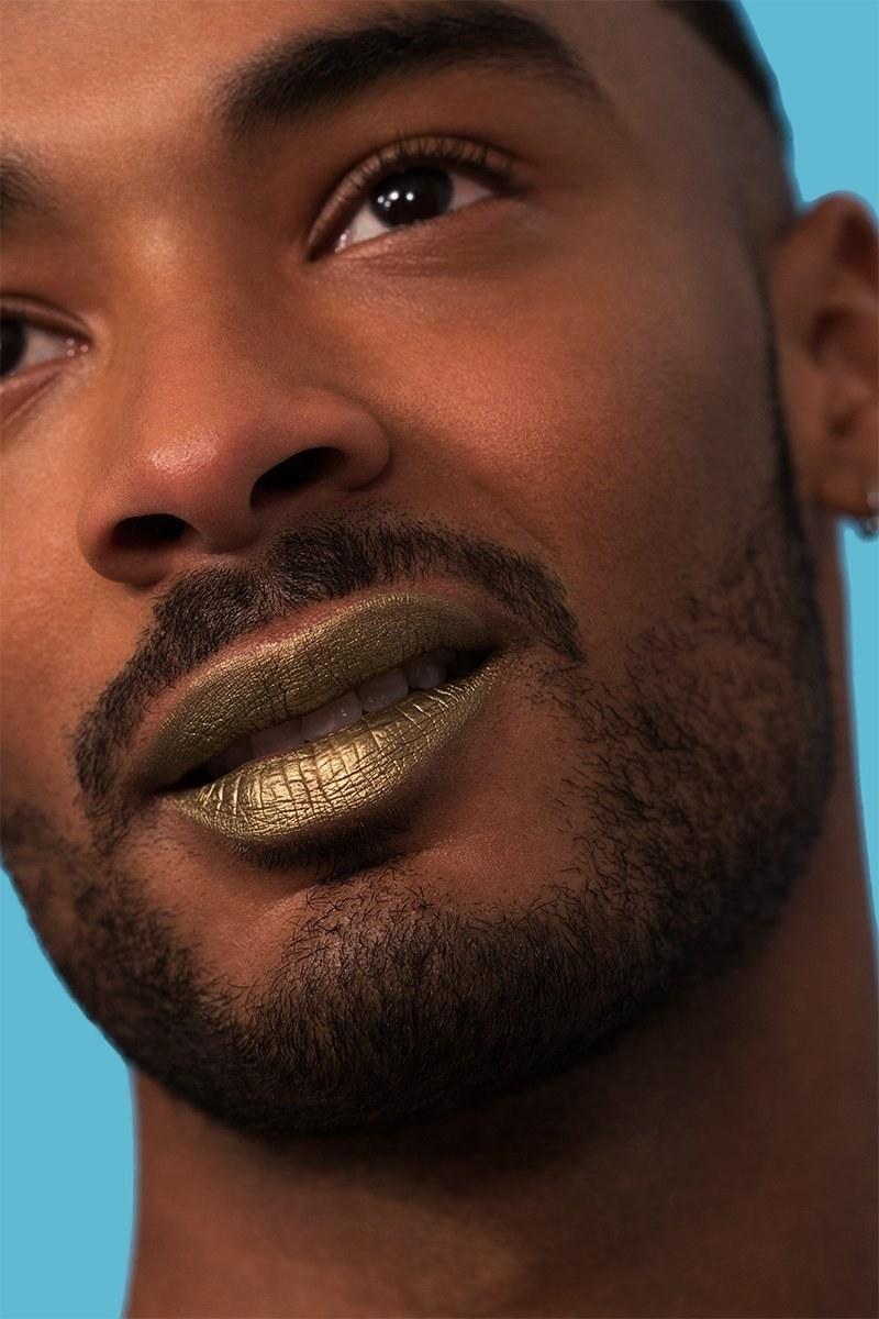 a model wearing the gold liquid lip