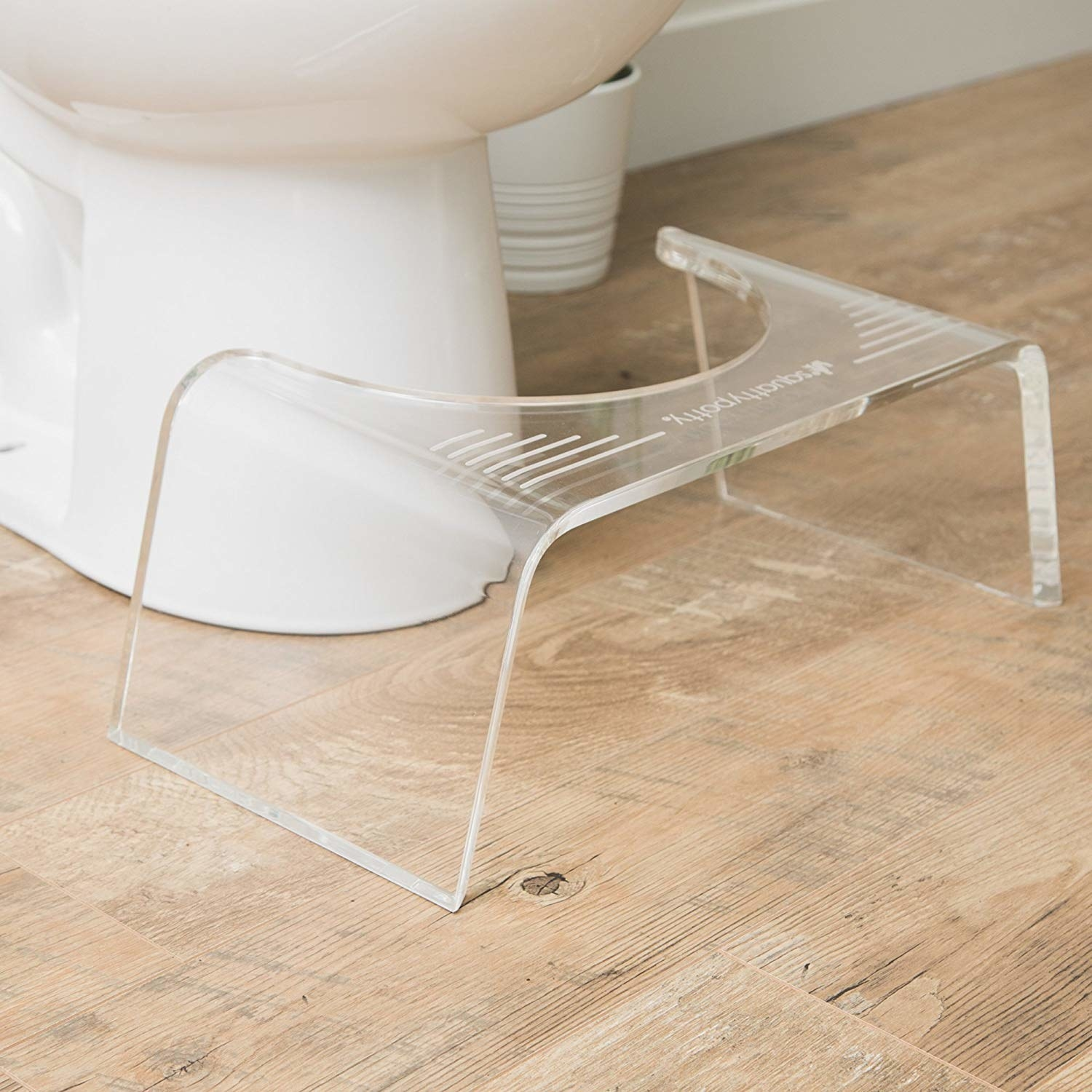 Acrylic Squatty Potty in front of toilet