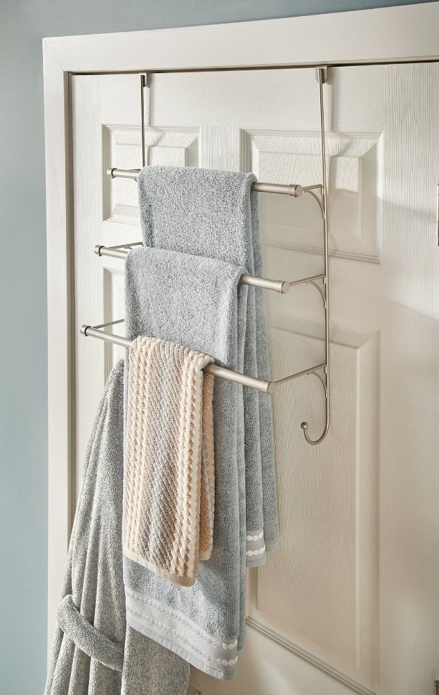 Three-tiered over-the-door towel rack