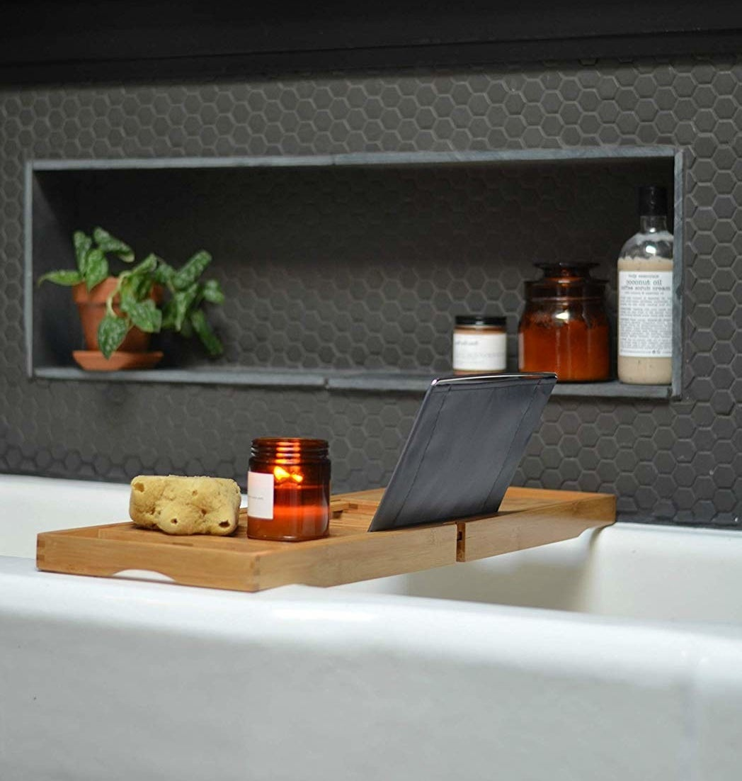 Bamboo bathtub tray with tablet propped up