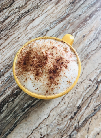 Reviewer photo of a latte with fluffy foam made by the frother