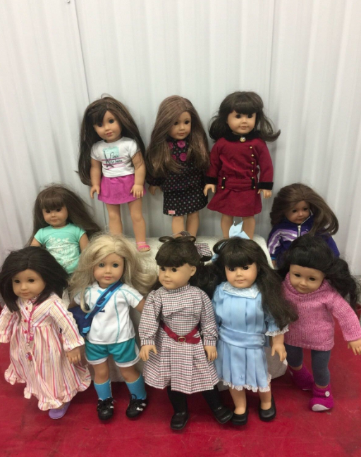 A collection of 10 American Girl dolls