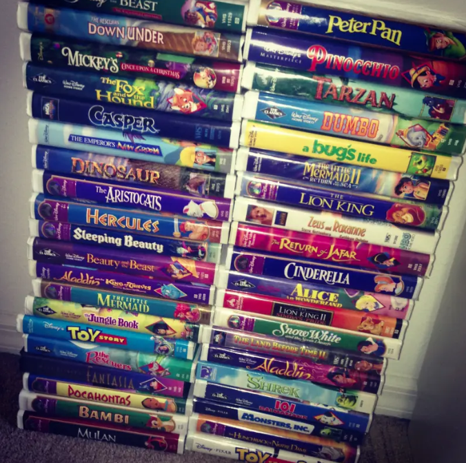 A stack of VHS clam shell movies