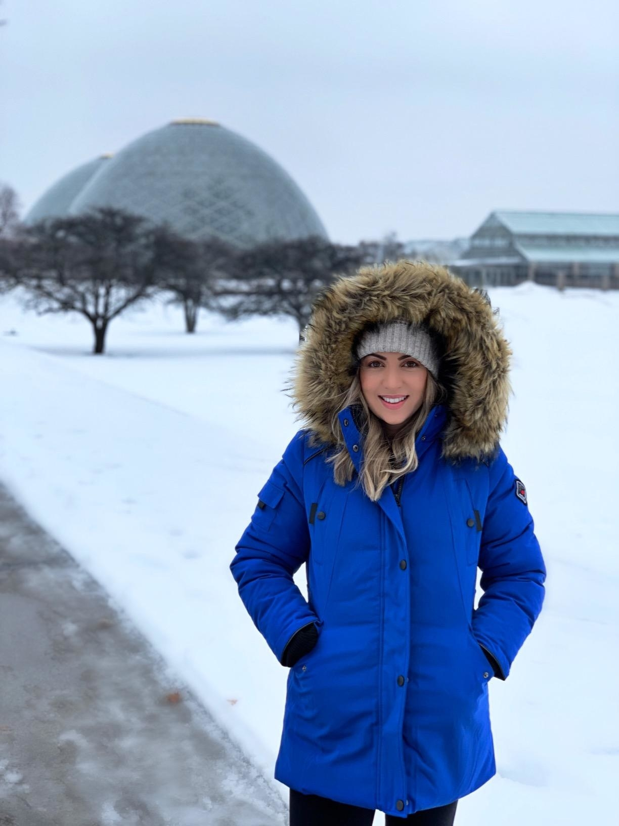 Reviewer wearing the parka in bright blue