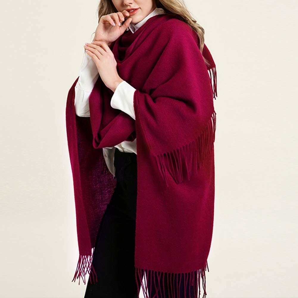 a model in the burgundy scarf with fringe