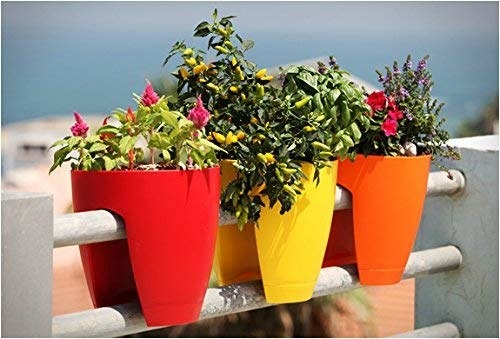 Red, orange, and yellow over-the-railing planters.