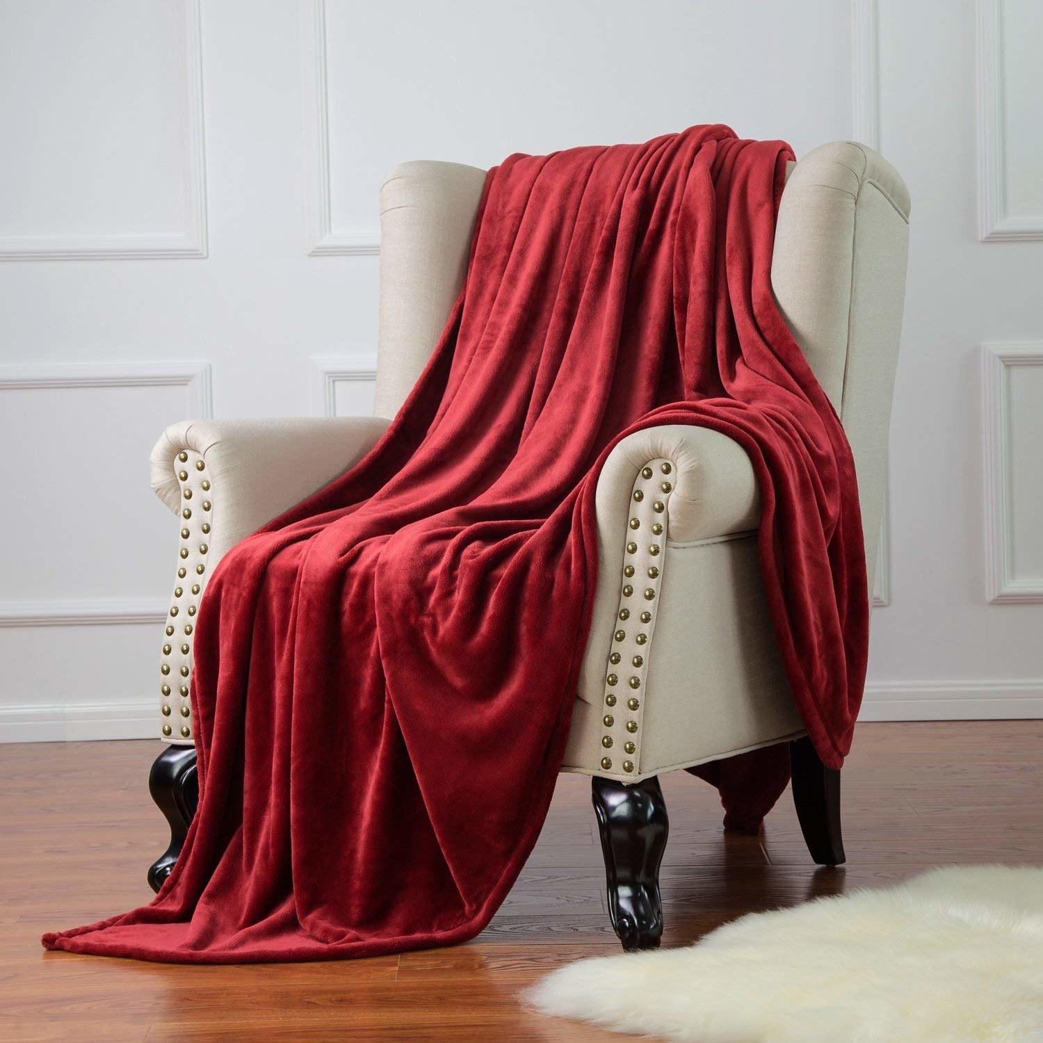 A large soft blanket draped over a chair