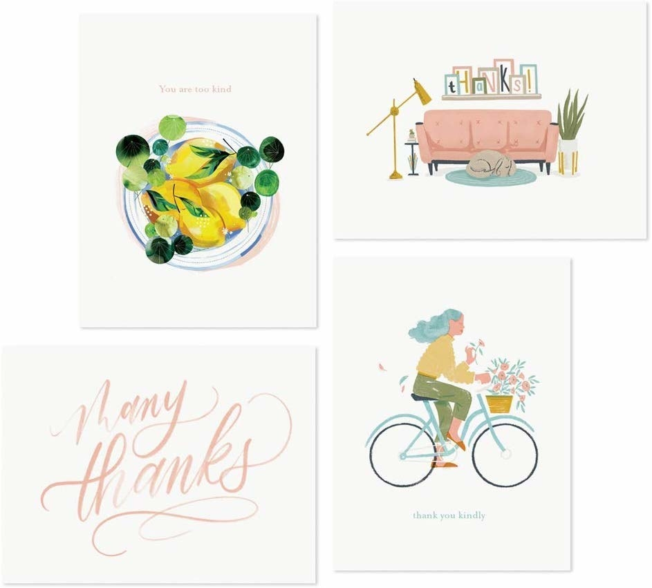 A set of four greeting cards with illustrations drawn on the front