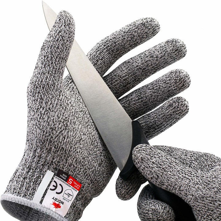 the gray, thick, cut resistant gloves with a knife pressed up against them