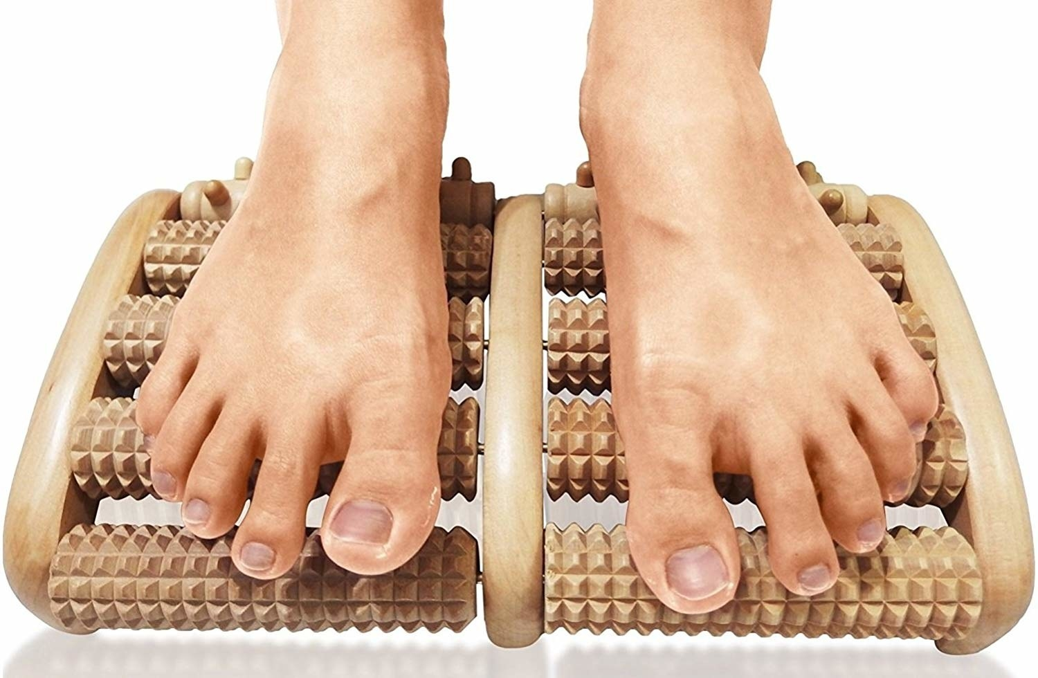 the wooden foot rest with multiple rollers under each foot