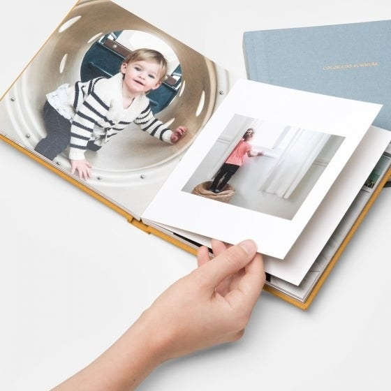 a model turning the pages of a photo album