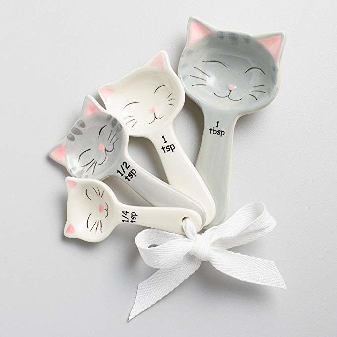 the cat spoons tied with a ribbon