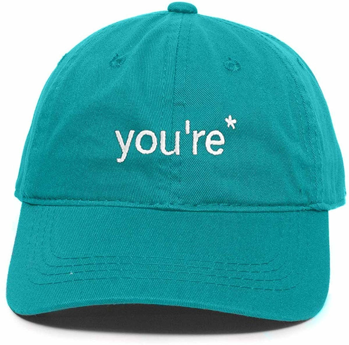 "teal baseball cap with white text that reads ""you're*"""