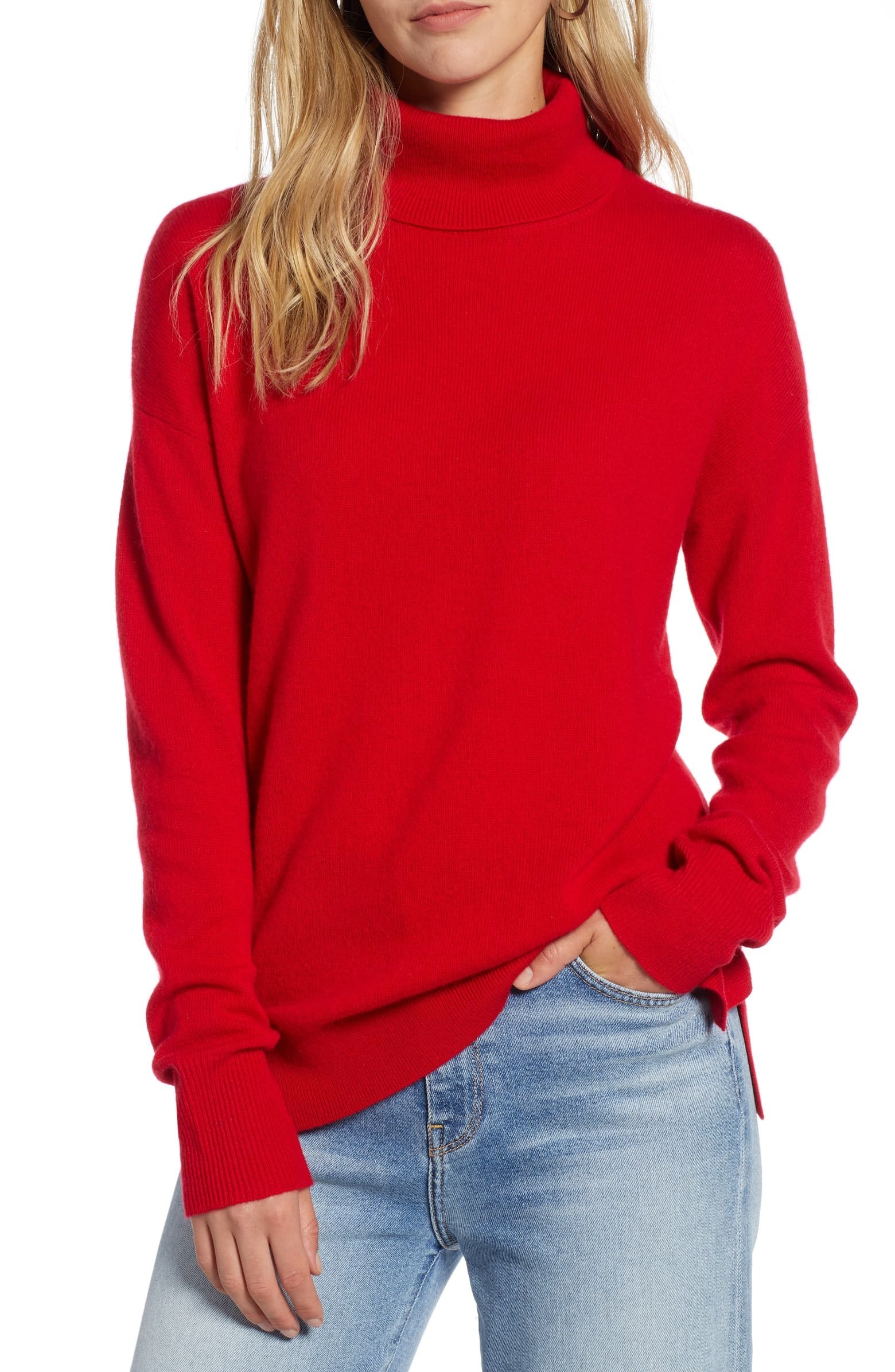 Model wearing the red turtleneck sweater