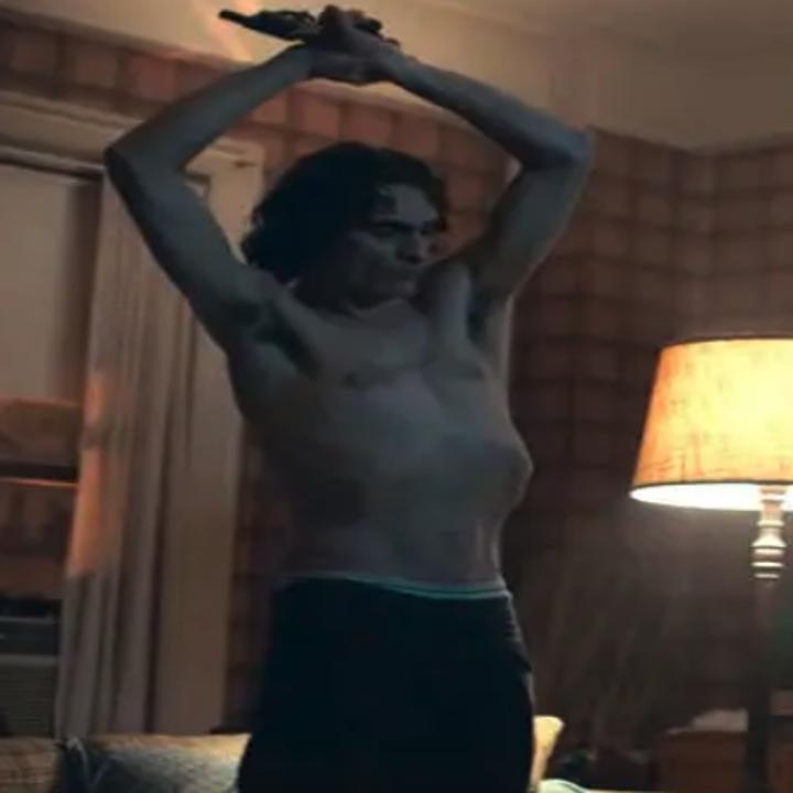 Joaquin Phoenix contorting his body as Arthur Fleck