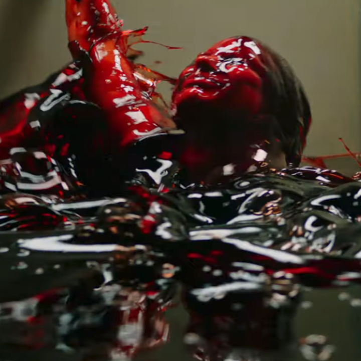 Jessica Chastain's character submerged in a pool of blood