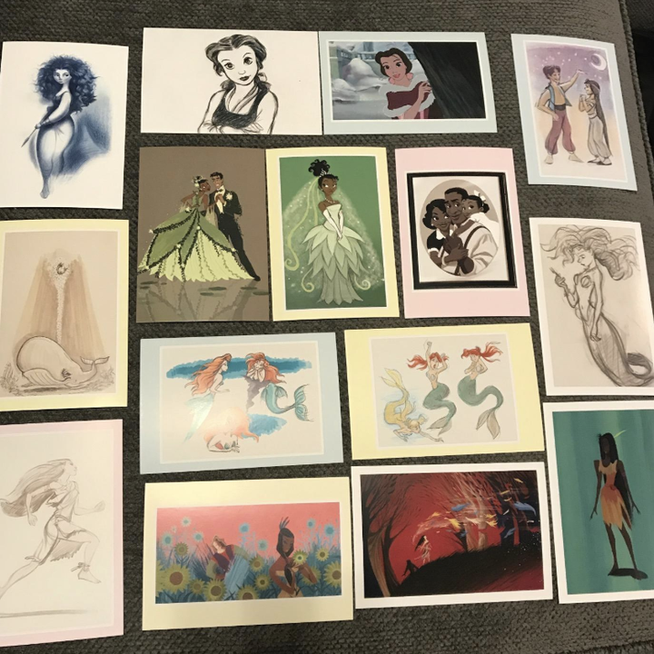 a reviewer showing an array of the princess postcards