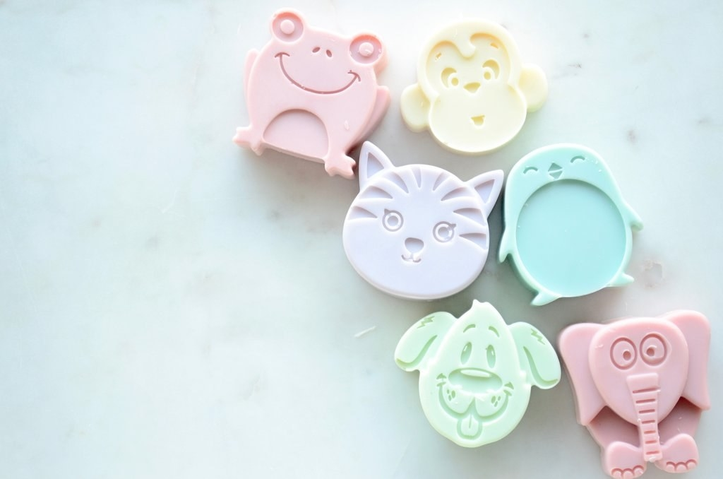 the assortment of colorful animal soaps