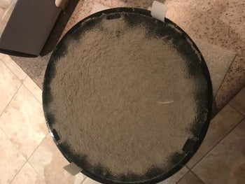 Reviewer photo of the filter showing how much dust it picked up