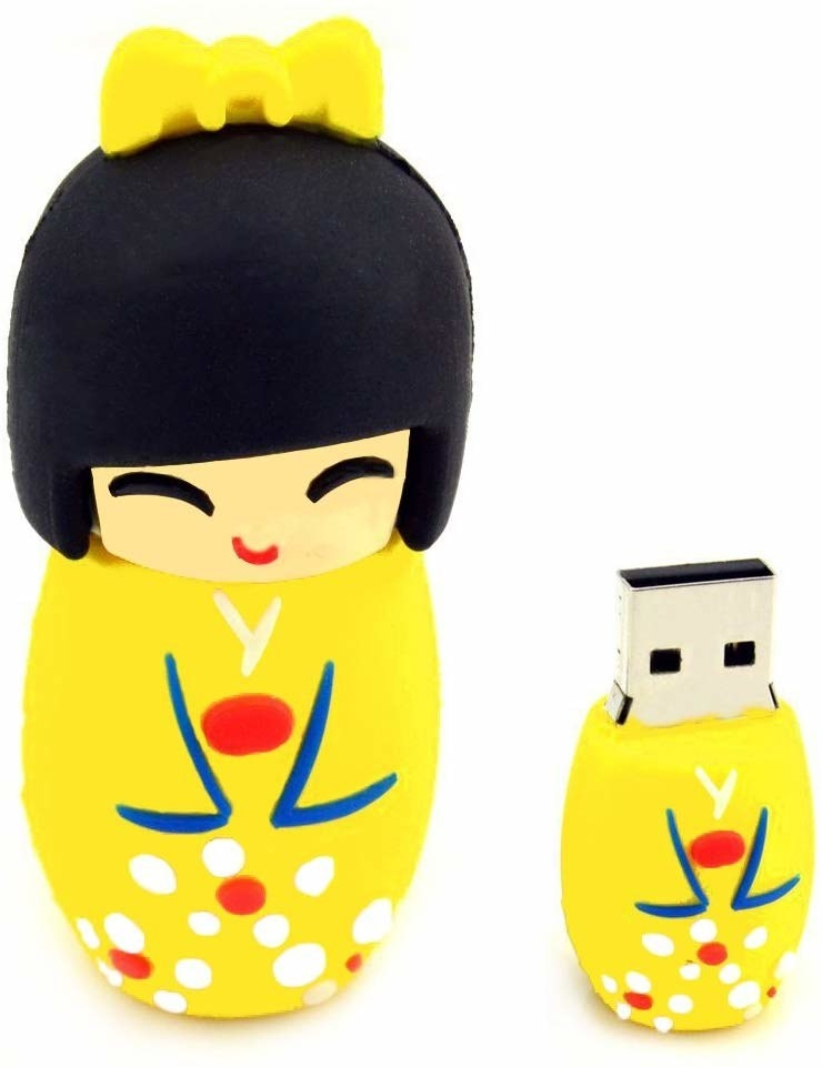 the flashdrive in the shape of a cute yellow traditional Japanese wooden doll
