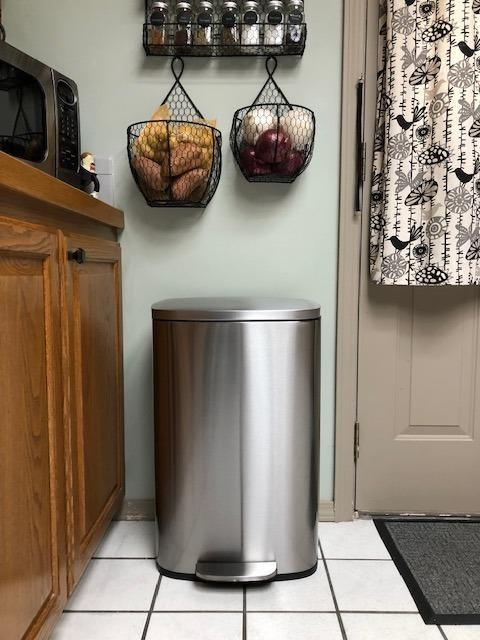 The stainless steel garbage can in a reviewer's kitchen